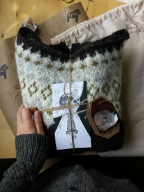 The sweater, bound in twine with a thank you card I illustrated based on a Grimms Fairy Tale